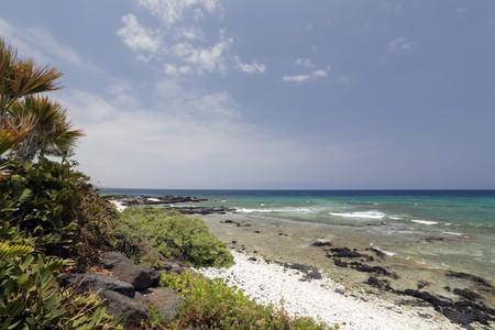 kona: Snorkeling Beach with White and Black Volcanic Rocks, Kona, HI Stock Photo