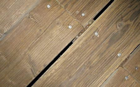 Segment of Old Wooden Walkway with Nail Heads and Gap Imagens - 4933795
