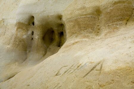 limestone caves: Limestone Wall with Caves and Holes; Nature Background Stock Photo