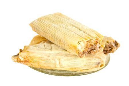 Three frozen tamales on plate Stock Photo