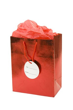 Red gift bag with tissue on white background photo