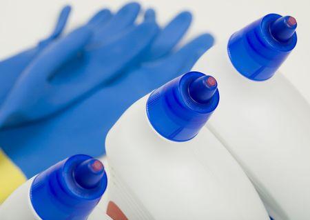 Three bottles of toilet bowl cleaner and bi-color gloves Stok Fotoğraf - 5701959