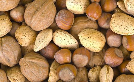 Mixed nuts background, close up, macro view Imagens