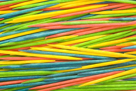 toothpick: Colored wooden toothpicks background, close up, macro view