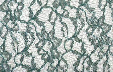 white fabric texture: Green lace on white spandex background, macro view Stock Photo