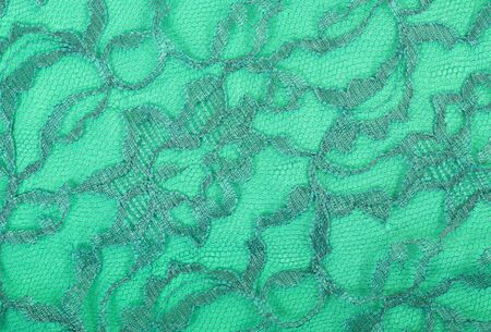 spandex: Green lace on green spandex background, macro view Stock Photo