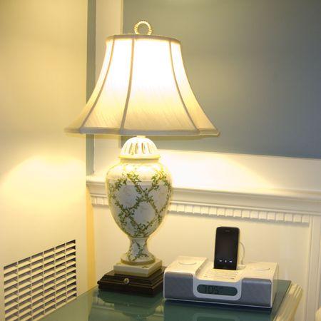 Corner Table with Night Lamp and Alarm Clock Radio photo