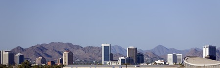 Cityscape of Phoenix Downtown against North-East Camelback Mountain Range photo