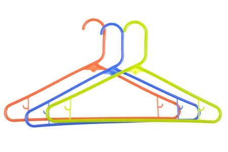 hangers: Blue, green and red plastic hangers; isolated on white background Stock Photo
