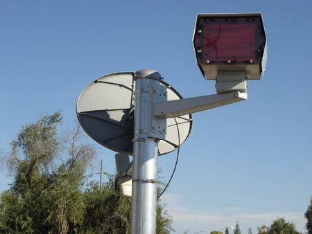 Radar flash with satellite device near highway                                photo