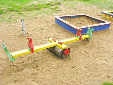Playground for kids with sandbox and seesaw photo
