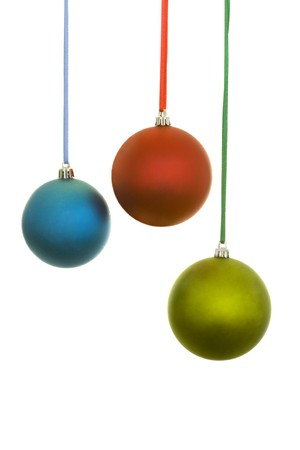 hang up: Christmas blue, red and yellow balls decoration with ribbons; isolated on white background Stock Photo