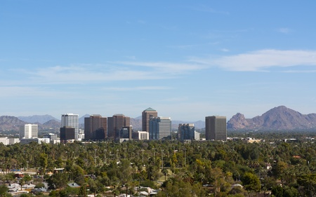 Arizona capital city of Phoenix uptown against east valley mountains