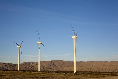 palm springs: Renewable electricity generating wind mill turbine towers in desert mountain corridor, Palm Springs, CA