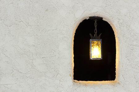 Outdoor lamp in stucco wall Banco de Imagens