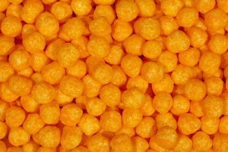 Puffy cheese balls, snack background Stock Photo - 9448792