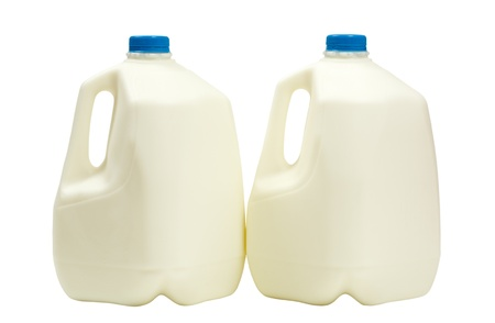 gallons: Two gallons of milk in plastic containers; isolated on white background