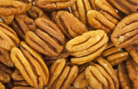Pecan halves macro view background; close up  Imagens