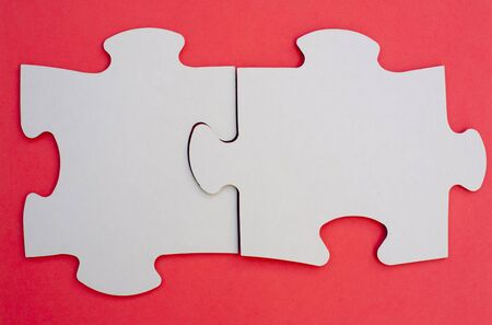 two piece: Two pieces of jigsaw puzzle on red cloth