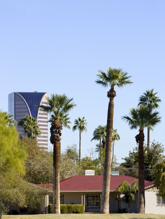 Modern office skyscraper and single store detached house, Phoenix, Arizona photo