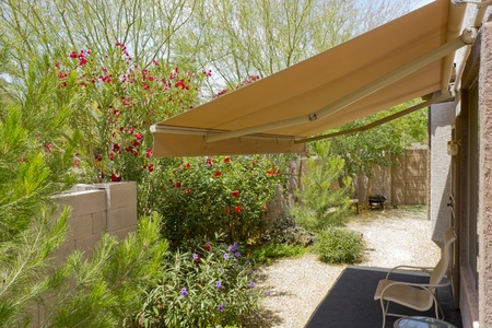 an awning: Backyard with retractable awning