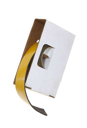 Foam insulation tape in cardboard box; isolated on white background Stock Photo - 17195600