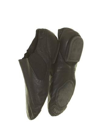 ballet slippers: Black leather dance ballet shoes; isolated on white background Stock Photo