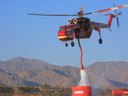 refills: MORONGO, US � JUNE 16, 2013: Ericcson Sky Crane, also known as Sykorsky S-640, refills air tanker with fire retardant during Hathaway fire in San Bernardino National Forest