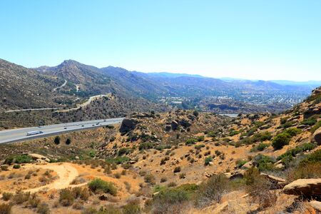 rocky peak: CA-118 highway in Simi Valley as seen from Rocky Peak Trail, Santa Susana Mountains, CA  backlit