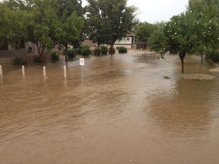 Submerged playground in monsoon rain waters, Phoenix, AZ