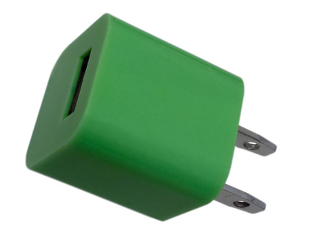 Green charging USB power adapter, isolated on white