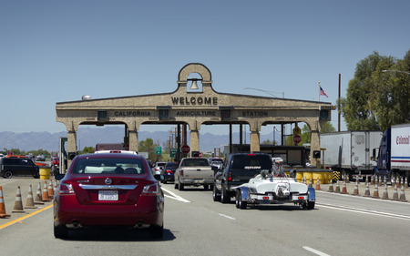BLYTH, CA - AUGUST 17, 2014  Cars lined up at California Agriculture Control near Arizona-California border crossing on Interstate-10