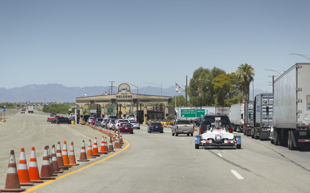 BLYTH, CA - AUGUST 17, 2014: Trucks and passengers cars lined up at California Agriculture Control near Arizona-California border crossing on Interstate-10