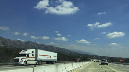 gabriel: Los Angeles, CA – September 19, 2014: Highway traffic in Sunland-Tujunga near San Gabriel Mountains along highway I-210, Los Angeles suburb, California Editorial