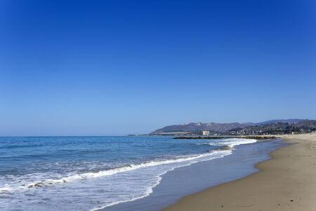 central california: Central beach and distant hotel strip in Ventura, California southern coast line