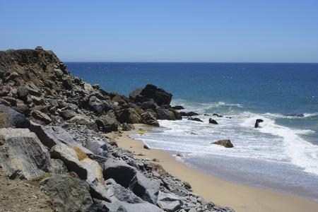 Rocky beach with sand near Point Mugu along PCH-1 in Ventura County, Southern California