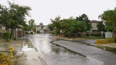Flooded Phoenix housing community streets after monsoon rain, Arizona 스톡 콘텐츠