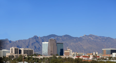 Cityscape of Tucson downtown against mountain range, Arizona