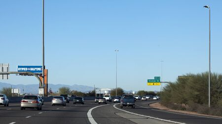 superbowl: GLENDALE, AZ - JANUARY 24, 2015: North bound traffic on Loop-101 toward University of Phoenix Cardinal Stadium where New England Patriots play Seattle Seahawks during Super Bowl 49 on February 1, 2015 Editorial