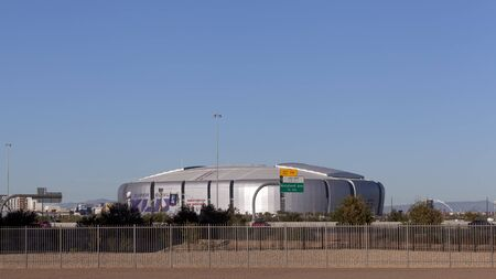superbowl: GLENDALE, AZ - JANUARY 24, 2015: University of Phoenix Cardinal Stadium getting ready for Super Bowl XLIX as seen across highway Loop 101, Glendale, Phoenix metro, Arizona. New England Patriots play Seattle Seahawks on February 1, 2015