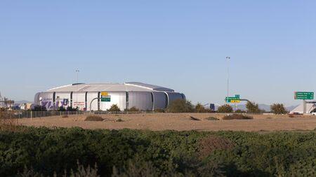 super bowl: GLENDALE, AZ - JANUARY 24, 2015: Undeveloped city area lot contrasting University of Phoenix Cardinal Stadium that hosts Super Bowl XLIX in Glendale, Phoenix metro, Arizona. New England Patriots play Seattle Seahawks on February 1, 2015