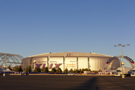 super bowl: GLENDALE, AZ - JANUARY 24, 2015: Evening cast golden color on silver dome of University of Phoenix Arizona Cardinal Stadium that dressed up for Super Bowl XLIX taking place on  February 1, 2015