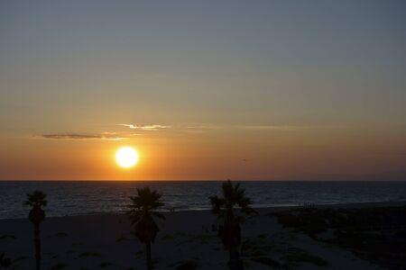 glow: Golden glow sunset over Mandalay Beach and Channel Islands, Oxnard, CA