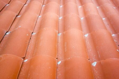 Overlapping red clay tiles set in wavy pattern