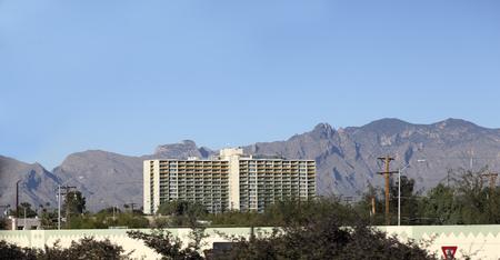 residential housing: Modern Tucson downtown high rise residential housing with Santa Catalina mountain range in background, Arizona Stock Photo