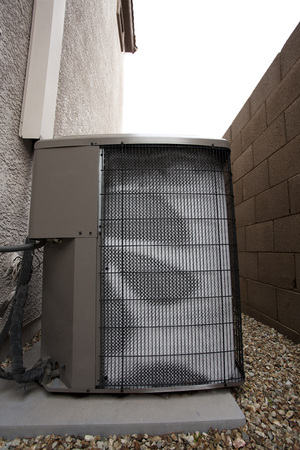 Air conditioner external compressor heat exchange unit (also referred as Heat Pump) covered with white frost in the backyard on cold and humid January morning