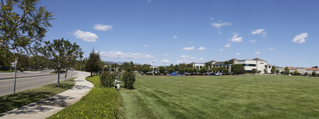 headquarter: CAMARILLO, CA - APRIL 8, 2015: Semtech corporate headquarter office across perfectly manicured green grassy field in Camarillo, California; , Neighborhood Panorama