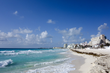 Crowded hotel zone along Caribbean sea coast always warm and sunny Cancun Mexico