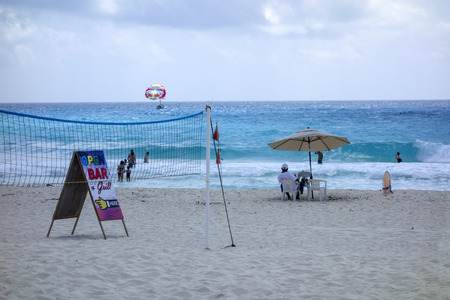 mx: CANCUN MX  May 17 2015: Lifeguard watching swimmers and parasailers from sandy shore of Caribbean beach in Cancun La Isla Dorado Mexico Editorial