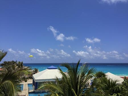 mx: CANCUN MX  May 17 2015: Recreational parasailing above Caribbean sea at Solymar Beach and Resort hotel Cancun Mexico
